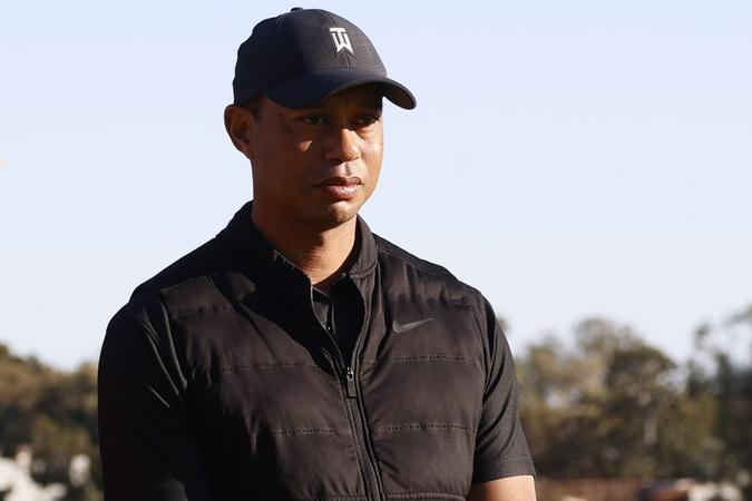 Mandatory Credit: Photo by Ryan Kang/AP/Shutterstock (11773177h)Tiger Woods looks on during the trophy ceremony on the practice green after the final round of the Genesis Invitational golf tournament at Riviera Country Club, in the Pacific Palisades area of Los AngelesGenesis Invitational Golf, Los Angeles, United States - 21 Feb 2021.