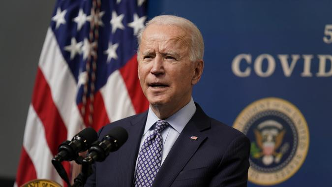 Mandatory Credit: Photo by Evan Vucci/AP/Shutterstock (11776013z)President Joe Biden speaks during an event to commemorate the 50 millionth COVID-19 shot, in the South Court Auditorium on the White House campus, in WashingtonBiden, Washington, United States - 25 Feb 2021.