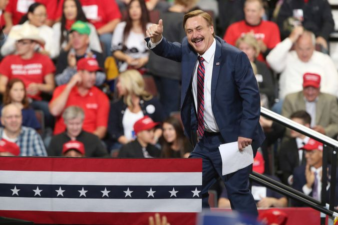 Mandatory Credit: Photo by Jim Mone/AP/Shutterstock (9915903b)Mike Lindell, inventor and founder of My Pillow, gives a thumbs up before a rally address by President Donald Trump, in Rochester, MinnElection 2018 Trump, Rochester, USA - 04 Oct 2018.