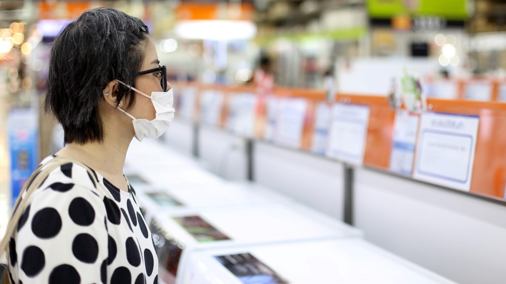The Asian woman going shopping with face mask.