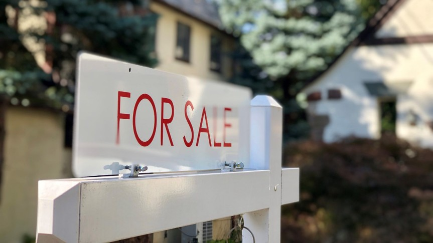 Real estate for sale sign in residential neighborhood, New Jersey, USA.