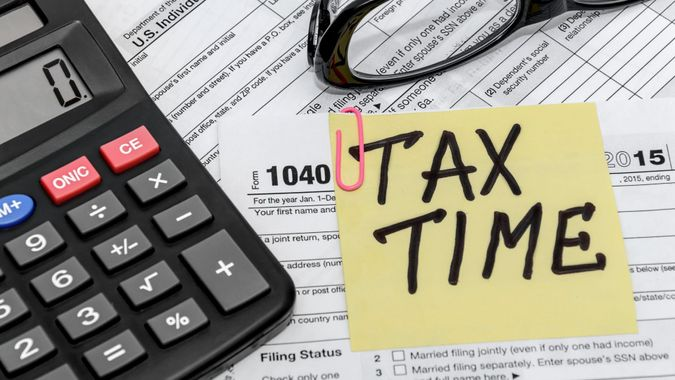 tax form with callculator and glasses.