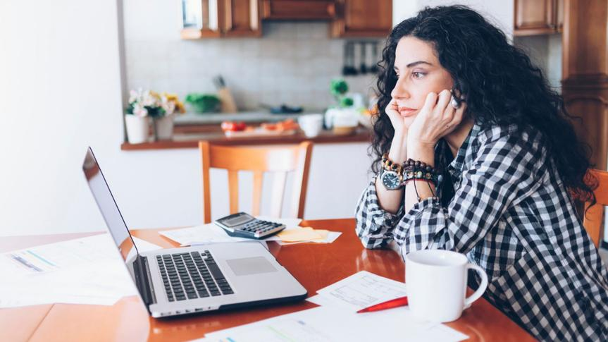 Young woman having problems and drinking coffee at home.