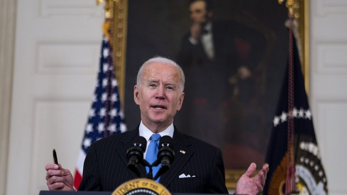Mandatory Credit: Photo by DOUG MILLS/Shutterstock (11782938ac)President Joe Biden delivers remarks on the ongoing COVID-19 pandemic in the State Dining Room of the White House, Tuesday, March, 2, 2021.