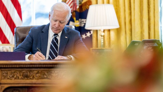 Mandatory Credit: Photo by Andrew Harnik/AP/Shutterstock (11796135c)President Joe Biden signs the American Rescue Plan, a coronavirus relief package, in the Oval Office of the White House, in WashingtonBiden, Washington, United States - 11 Mar 2021.