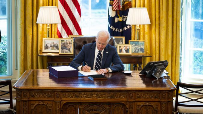 Mandatory Credit: Photo by Doug Mills/UPI/Shutterstock (11796190a)President Joe Biden signs the American Rescue Plan on in the Oval Office, Thursday, March, 11, 2021.