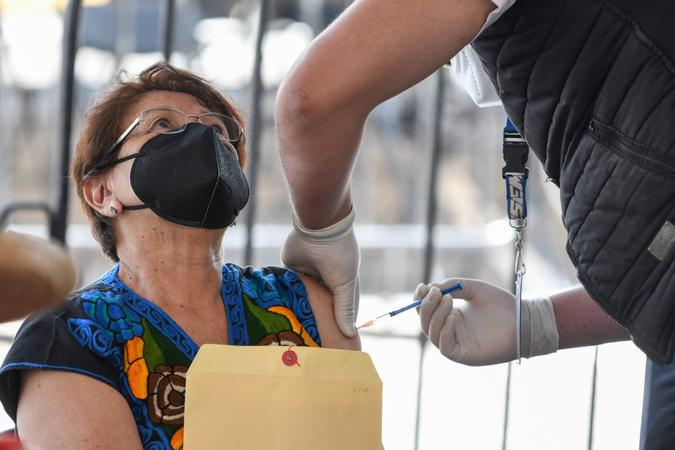 Mandatory Credit: Photo by Eyepix/NurPhoto/Shutterstock (11835979c)A health worker apply a dose of Covid-19 Pfizer-BioNTech during a mass vaccination program to immunize Elderlies more that 60 years of age at Toluca Technological Institute.