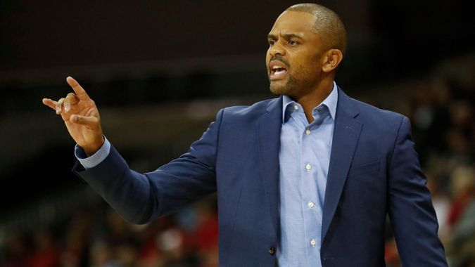 Mandatory Credit: Photo by AP/Shutterstock (9226043g)Coppin State's head coach Juan Dixon works the bench in the first half of an NCAA college basketball game against Cincinnati, in Cincinnati.
