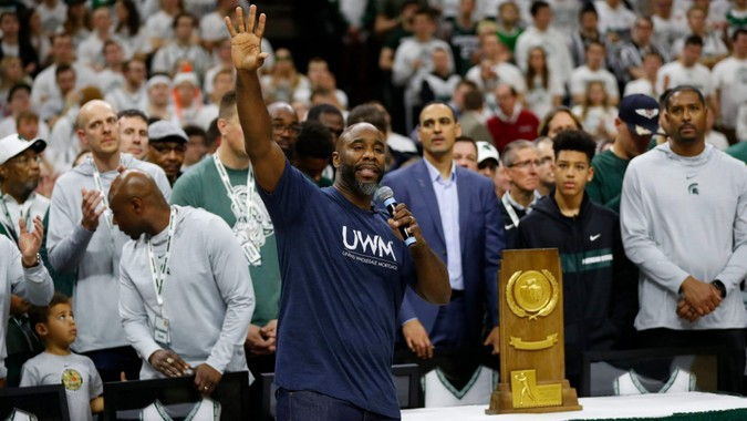 Mandatory Credit: Photo by Paul Sancya/AP/Shutterstock (10557905p)Mateen Cleaves waves to the crowd as the Michigan State 2000 national championship team is recognized during halftime of an NCAA college basketball game against Maryland in East Lansing, MichMaryland Michigan St Basketball, East Lansing, USA - 15 Feb 2020.