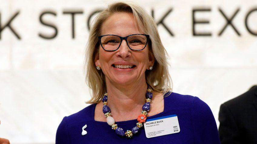 Mandatory Credit: Photo by Richard Drew/AP/Shutterstock (10314784b)Hershey Company President & CEO Michele Buck poses for photos before ringing the New York Stock Exchange closing bell, to celebrate the 125th anniversary of the company's foundingFinancial Markets Wall Street Hershey, New York, USA - 18 Jun 2019.