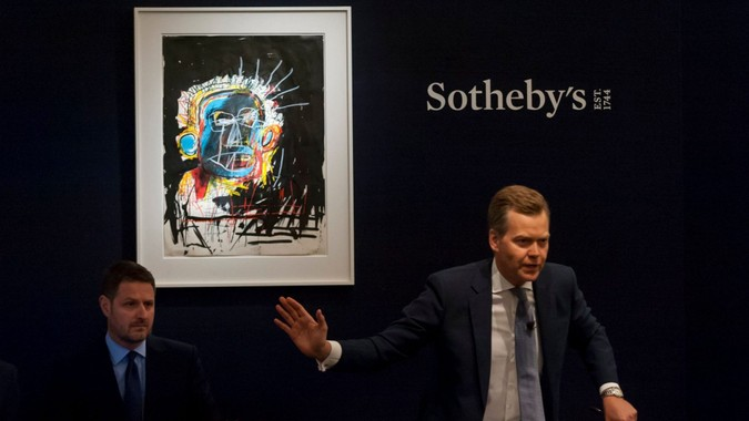 Mandatory Credit: Photo by Stephen Chung/Lnp/Shutterstock (9728290b)Sotheby's Oliver Barker fields bids for ''Untitled'' by Jean-Michel Basquiat, (Est.