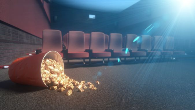 fallen bucket of popcorn in an abandoned movie theater, during the epidemic of the coronavirus 3d render.