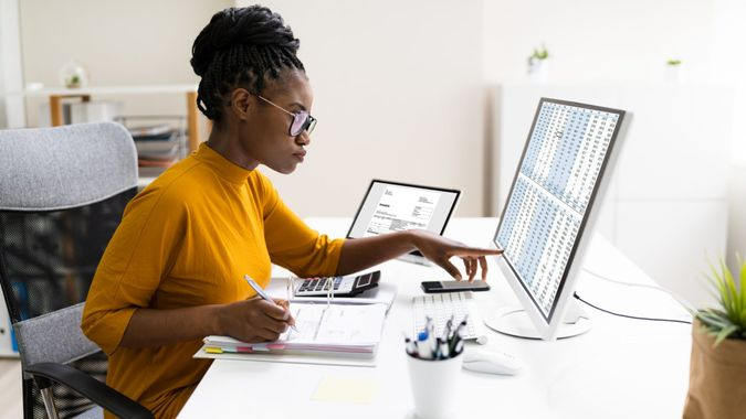 African Professional Chartered Accountant Woman Doing Tax.
