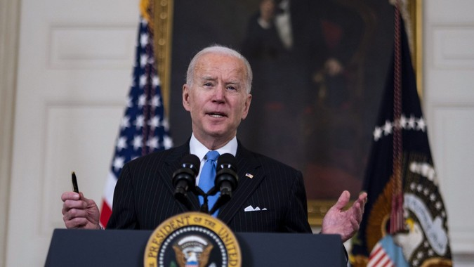Mandatory Credit: Photo by DOUG MILLS/UPI/Shutterstock (11782938ac)President Joe Biden delivers remarks on the ongoing COVID-19 pandemic in the State Dining Room of the White House, Tuesday, March, 2, 2021.