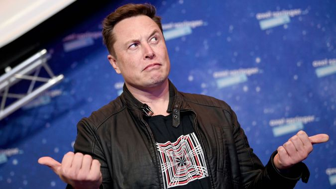 Mandatory Credit: Photo by Britta Pedersen/AP/Shutterstock (11088658i)SpaceX owner and Tesla CEO Elon Musk arrives on the red carpet for the Axel Springer media award, in Berlin, GermanyMusk, Berlin, Germany - 01 Dec 2020.