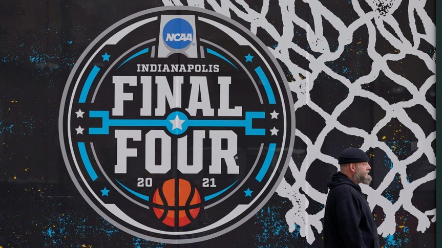 Mandatory Credit: Photo by Darron Cummings/AP/Shutterstock (11804196h)The NCAA Final Four logo for the NCAA college basketball tournament is painted on a window in downtown IndianapolisNCAA Tournament Fans Basketball, Indianapolis, United States - 17 Mar 2021.