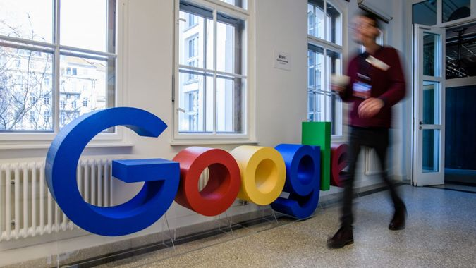Mandatory Credit: Photo by CLEMENS BILAN/EPA-EFE/Shutterstock (10070410ad)An employee walks past a Google logo at the new Google office in Berlin, Germany, 22 January 2019.