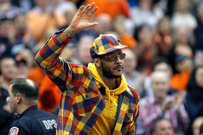 Mandatory Credit: Photo by Nick Lisi/AP/Shutterstock (10468138d)Former Syracuse basketball great Carmelo Anthony waves to the crowd during the first half of an NCAA college basketball game against Virginia in Syracuse, N.