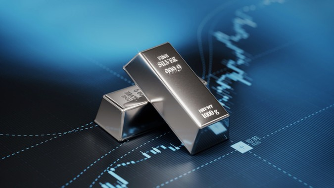Silver bars sitting on blue graph