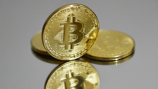 Mandatory Credit: Photo by Sheldon Cooper/SOPA Images/Shutterstock (11798560h)In this photo illustration the Bitcoins are seen on display.