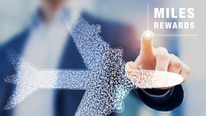 Air miles rewards with person touching airplane shape, frequent flyer loyalty program to earn points and bonuses for travel benefits like elite cards, airport lounge, business or first class flights.