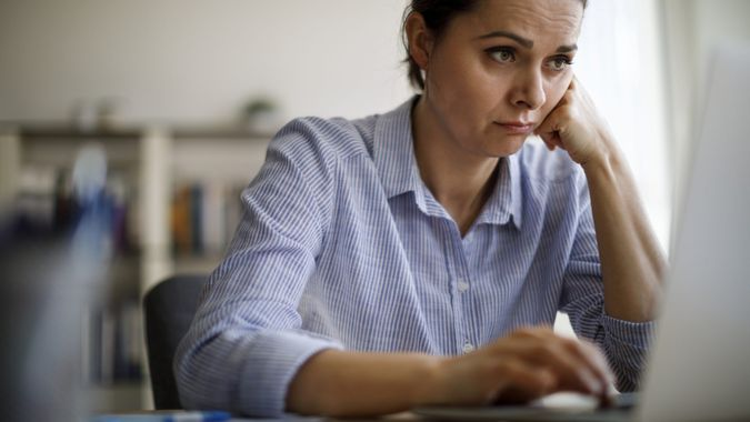 Woman struggling with new technology.