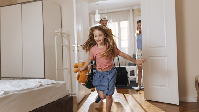 Shot of a happy family entering their accomodation.