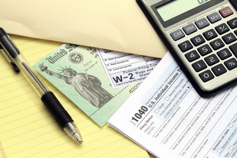 Tax forms with Treasury check.
