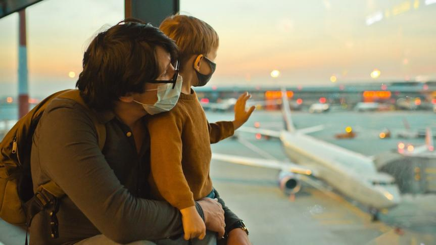 Father and son traveling by plane.