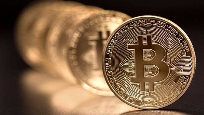 Sofia, Bulgaria - April 24, 2014: Studio shot of  bitcoin in a row on black background .