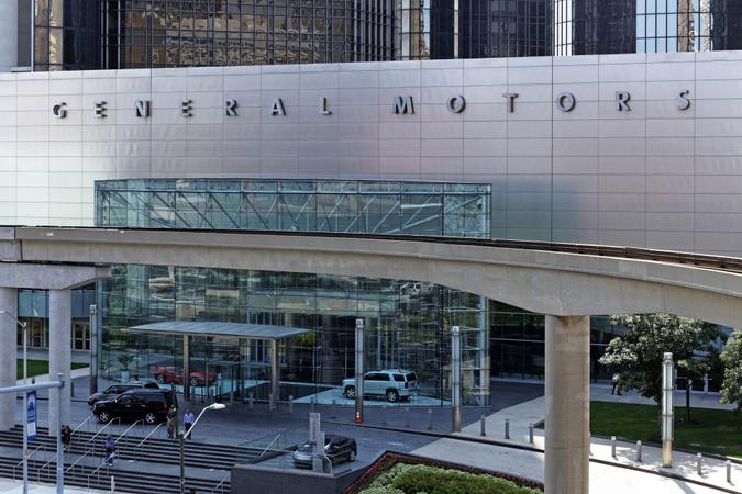 Detroit, MI, USA – July 31, 2014: People exit the General Motors World Headquarters building located in Detroit, Michigan.