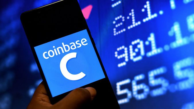 Mandatory Credit: Photo by Avishek Das/SOPA Images/Shutterstock (11863354e)In this Photo illustration of a Coinbase logo seen displayed on a Smartphone.