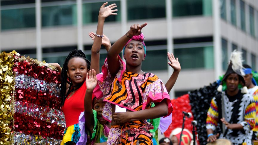 Children on a float wave to the crowd during the annual Juneteenth parade in Center City Philadelphia, PA, on June 23, 2018.