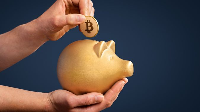 Investing savings in Bitcoin is gold stock photo