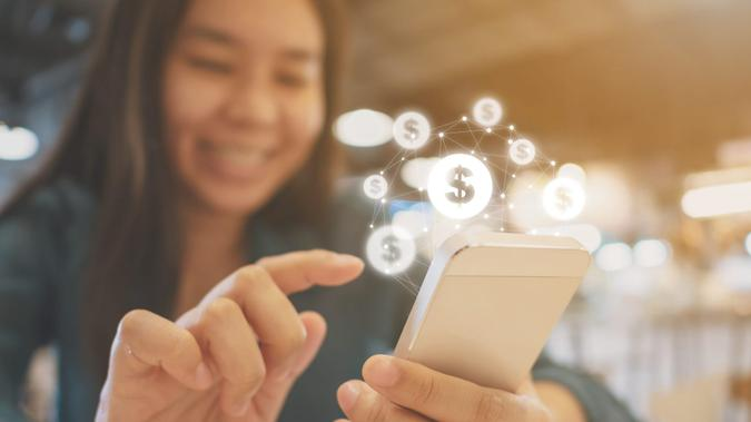 Asian woman hand using mobile phone with online transaction application, Concept financial technology (fin-tech).