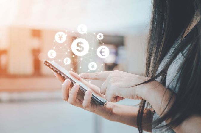 Close up image hand using mobile phone with online transaction application, Concept financial technology (fin-tech) and ICO Initial coin offering business financial internet innovation technology.