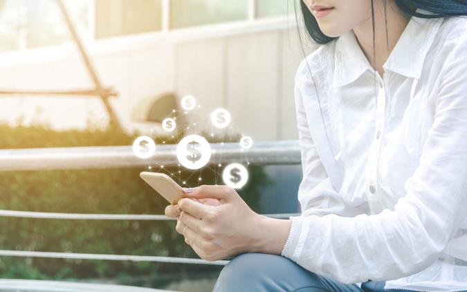 Asian woman hand using mobile phone with online transaction application, Concept financial technology (fintech).