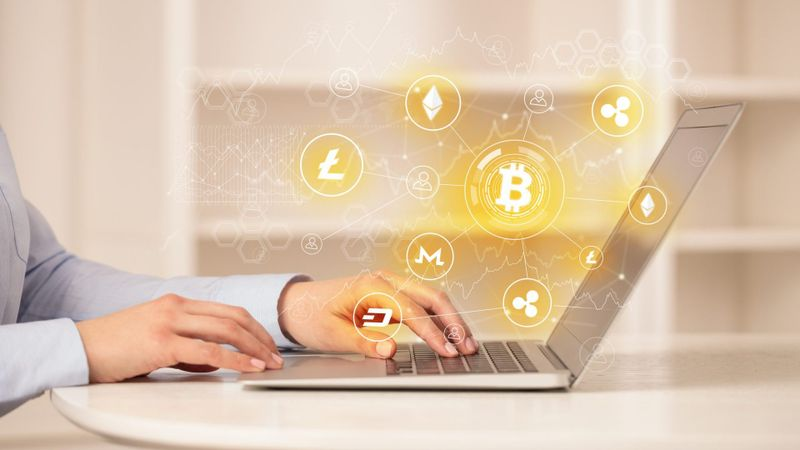 Business woman working on tablet with cryptocurrency bitcoin link network and online concept.