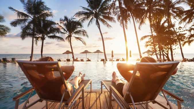 luxury travel, romantic beach getaway holidays for honeymoon couple, tropical vacation in luxurious hotel.