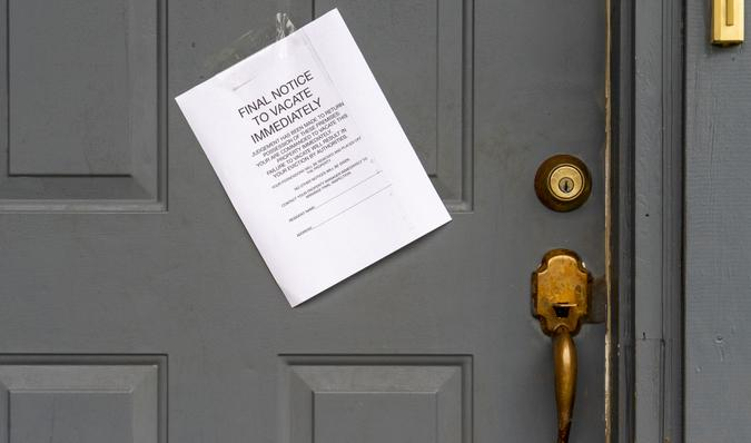 Eviction Final Notice to Vacate Immediately on House Door.