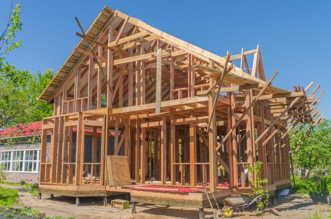 construction frame house made of wood, with roof rafters metal, profiled.