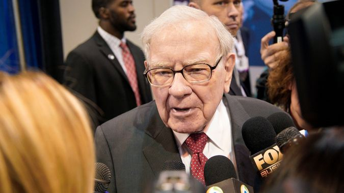 Mandatory Credit: Photo by Nati Harnik/AP/Shutterstock (10228126b)Warren Buffett, Chairman and CEO of Berkshire Hathaway, speaks to reporters during a tour of the CHI Health convention center where various Berkshire Hathaway companies display their products, before presiding over the annual shareholders meeting in Omaha, Neb.
