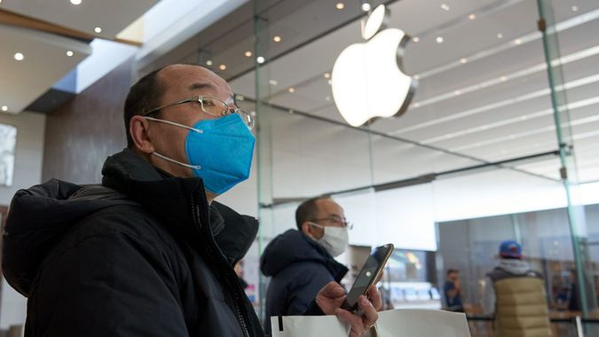 Mandatory Credit: Photo by Andre Pichette/EPA-EFE/Shutterstock (10583908c)People wearing face masks walk past an Apple store in Brossard, on the south shore of Montreal, Canada, 15 March 2020.