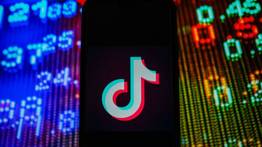 Mandatory Credit: Photo by Omar Marques/SOPA Images/Shutterstock (11683098x)In this photo illustration, a TikTok logo seen displayed on a smartphone with stock market prices in the background.