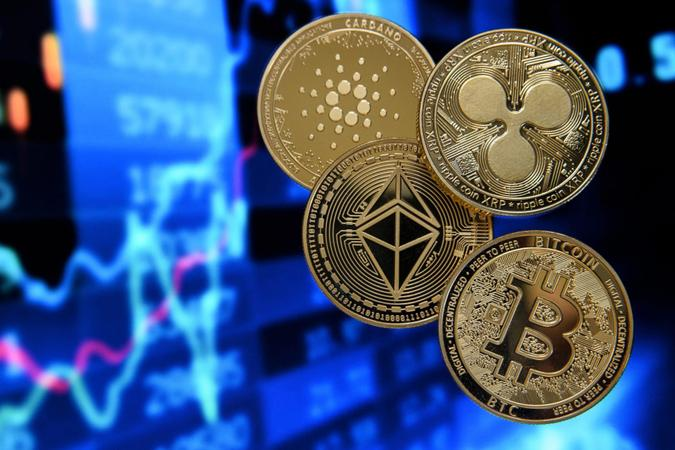 Mandatory Credit: Photo by SASCHA STEINBACH/EPA-EFE/Shutterstock (11718315m)Illustration of cryptocurrencies such as Bitcoin (bottom-R), Ethereum (C), Ripple (R) and Cardano (L) on a monitor showing a stock barometer, Duesseldorf, Germany, 20 January 2021.