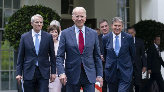 Mandatory Credit: Photo by SARAH SILBIGER/POOL/EPA-EFE/Shutterstock (12168186b)US President Joe Biden walks out of the West Wing of the White House following a meeting with a bipartisan group of Senators where they reached a deal on an infrastructure plan in Washington, DC, USA, 24 June 2021.