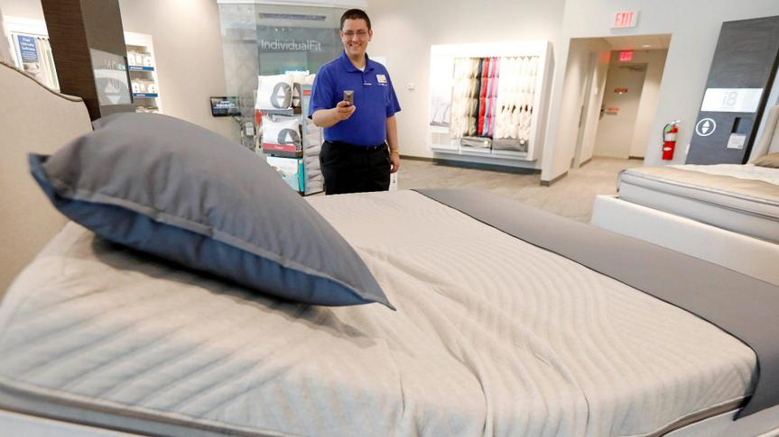 Mandatory Credit: Photo by AP/Shutterstock (8924685b)John Yelverton demonstrates the sleep technology that not only tracks your sleeping patterns, but works in concert with a number of features of the Sleep Number 360 Smart Bed, including a foot warming element, adjustable side comfort, head and foot raising capability and an analysis of how well a person slept.