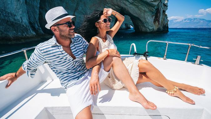Couple in love enjoying summer vacations on a yacht in Zakynthos Greece - Navagio beach and having fun traveling again during coronavirus outbreak stock photo