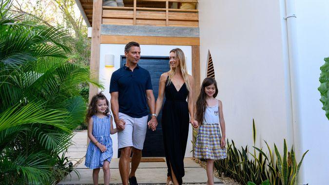 Family enjoying a luxury vacation stock photo