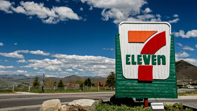 Park City, UT, May 12, 2017: 7-Eleven sign against a picturesque landscape is brightly lit by the sun.